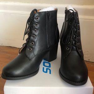 Black heeled combat booties